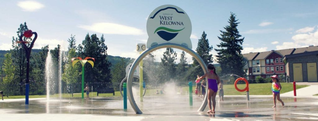 kids spray park west kelowna cool down